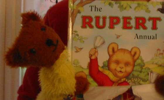 Yellow and Brown Teddy with Rupert Bear book