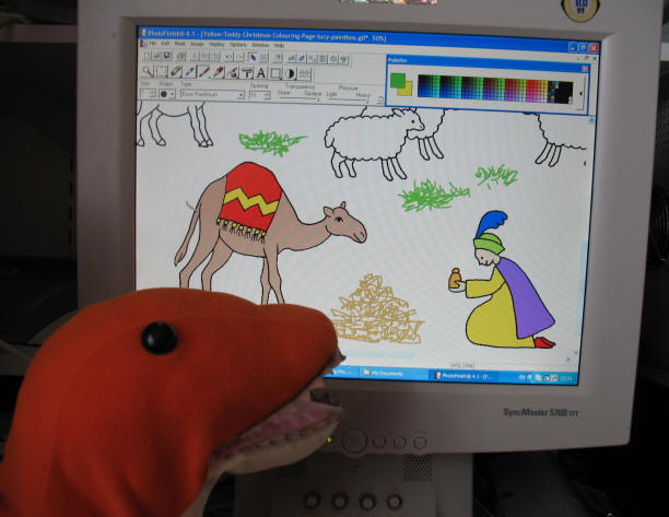 Dino colouring the Christmas Story page on screen
