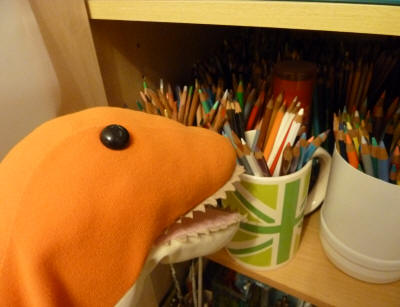 Dino choosing pencils from the art cupboard