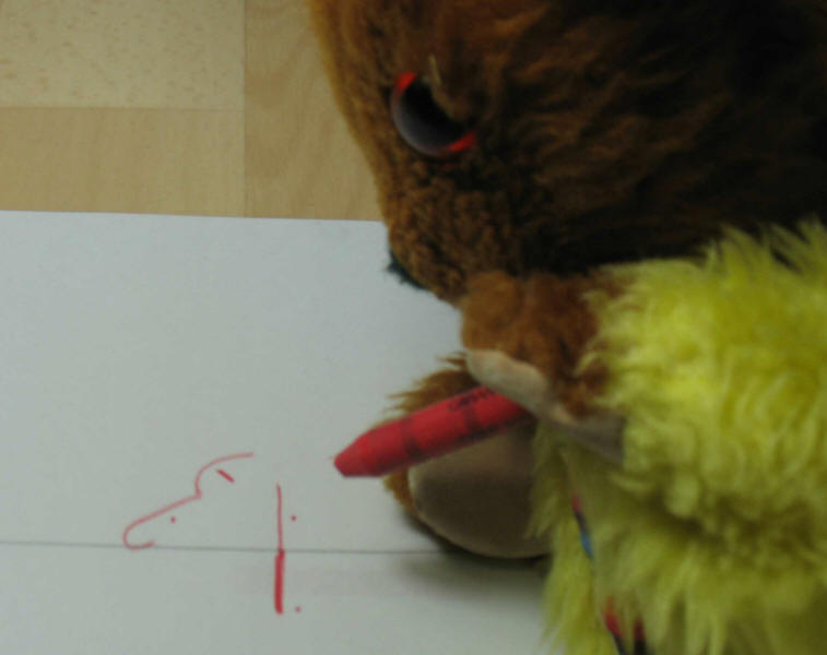 Yellow Teddy writing his name in shorthand