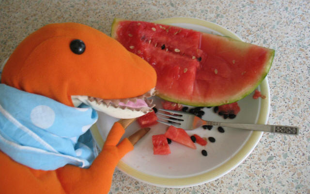 Dino with red melon